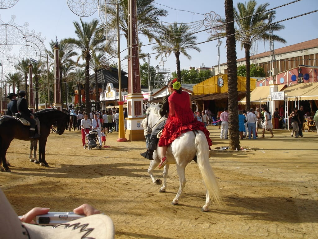 Mujer sobre un caballo